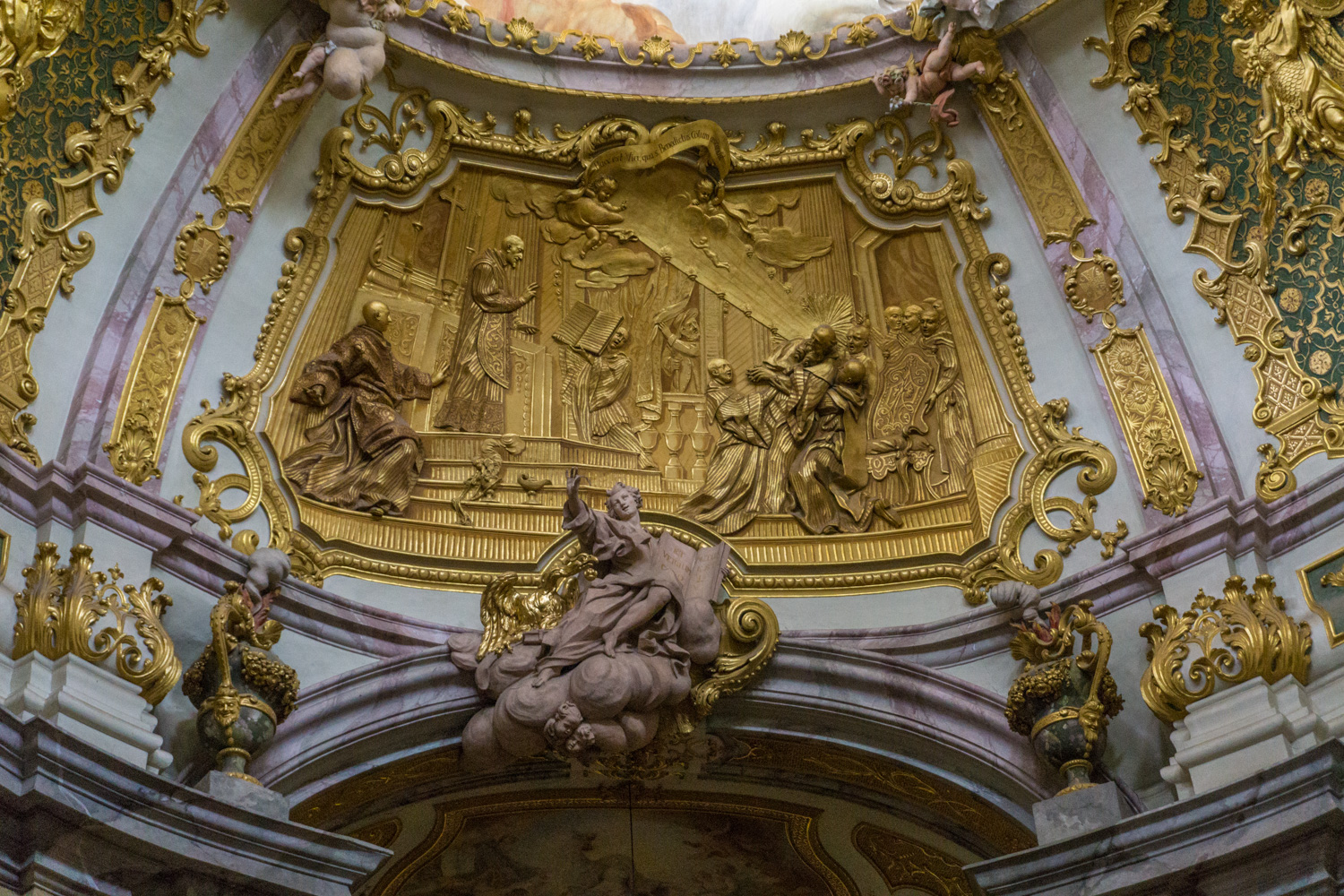 gold relief image above the altar