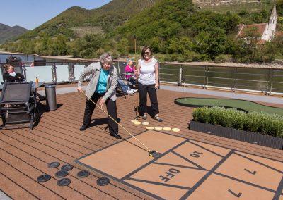 Karen & Joyce play shuffleboard